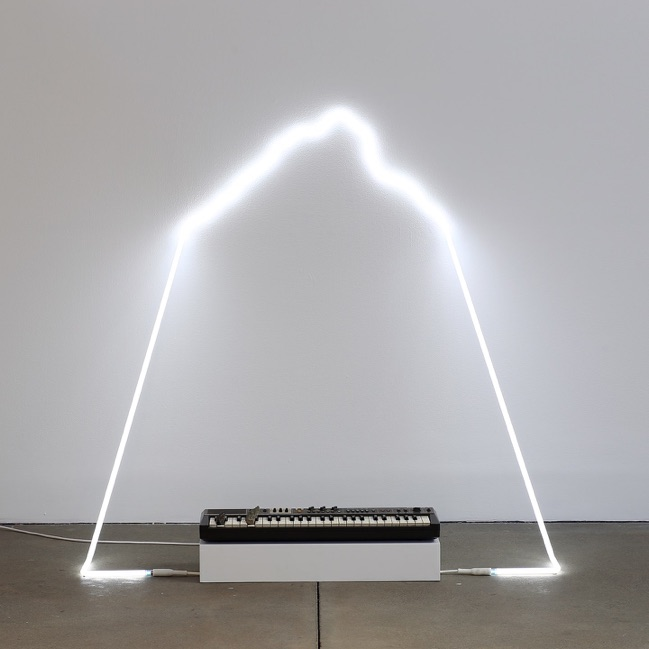 in defiance of being #5, 2014 neon, Casiotone MT-68 keyboard, rocks, dimensions variable