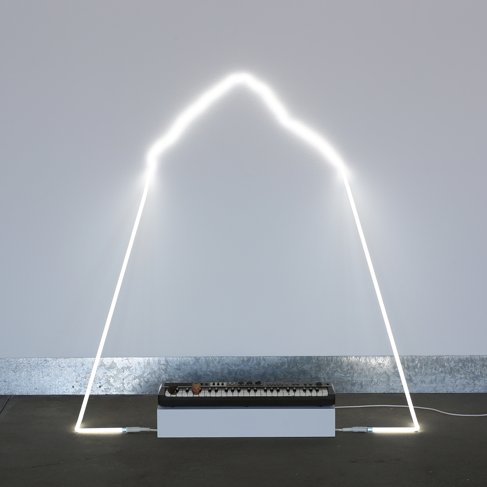 in defiance of being #7, 2014  neon, Casiotone MT-68 keyboard, rocks, dimensions variable