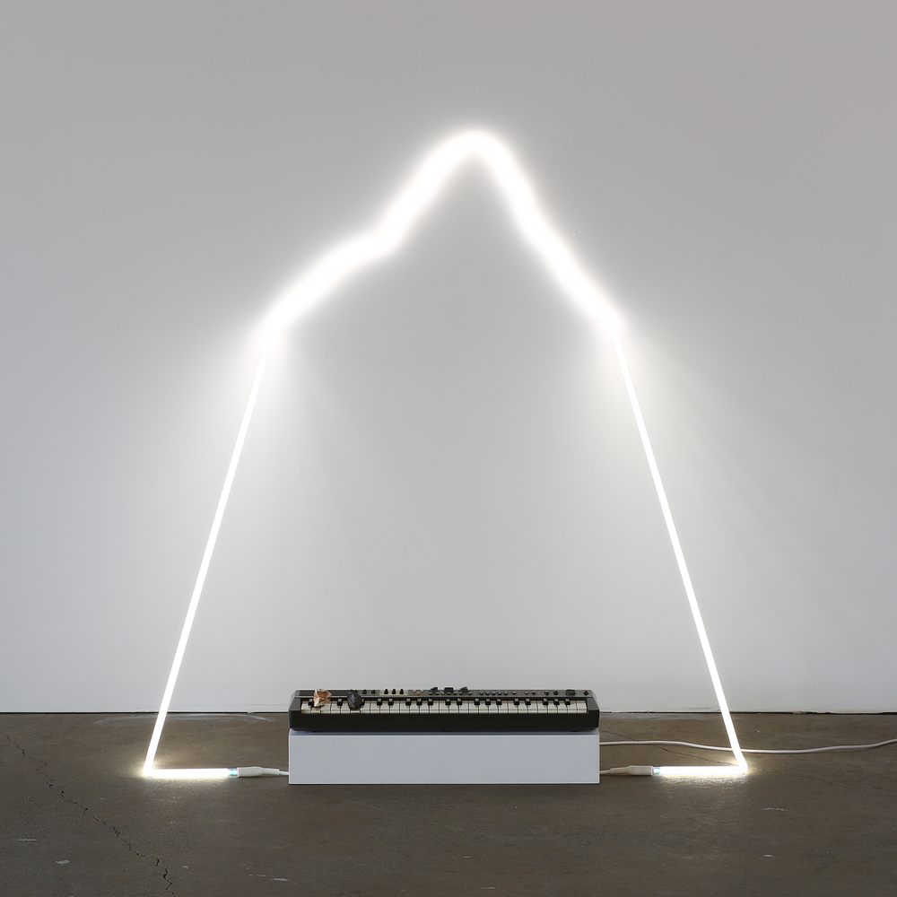 in defiance of being #6, 2014  neon, Casiotone MT-68 keyboard, rocks, dimensions variable