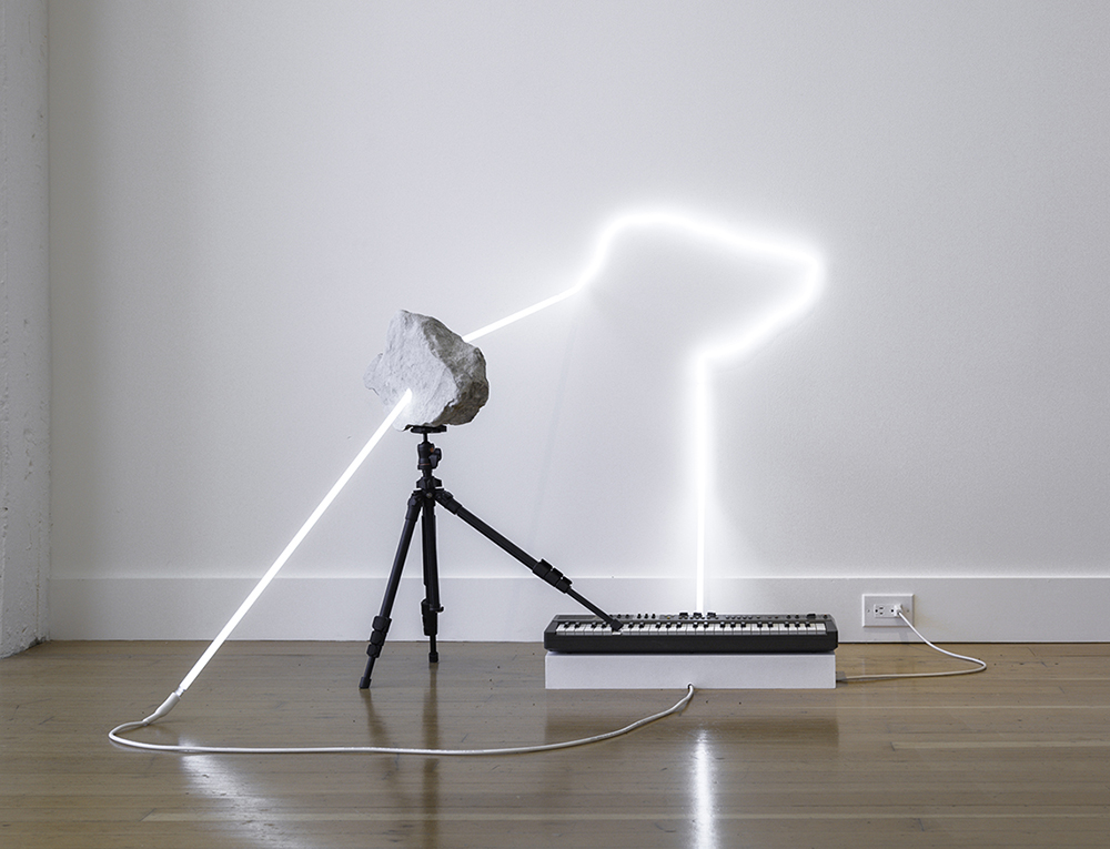 in defiance of being here #9, 2016 neon, tripod, Casiotone MT-69 keyboard, rocks, dimensions variable