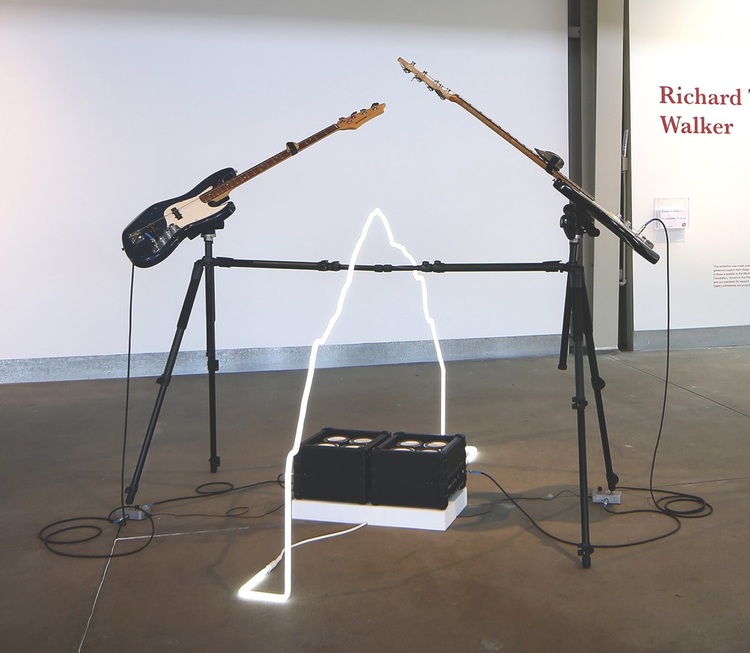 the predictability of happenstance / the shape of together, 2015 neon, Johnson bass guitars, Roland bass amplifiers, Electro-Harmonics Freeze pedals, tripods, rocks. dimensions variable