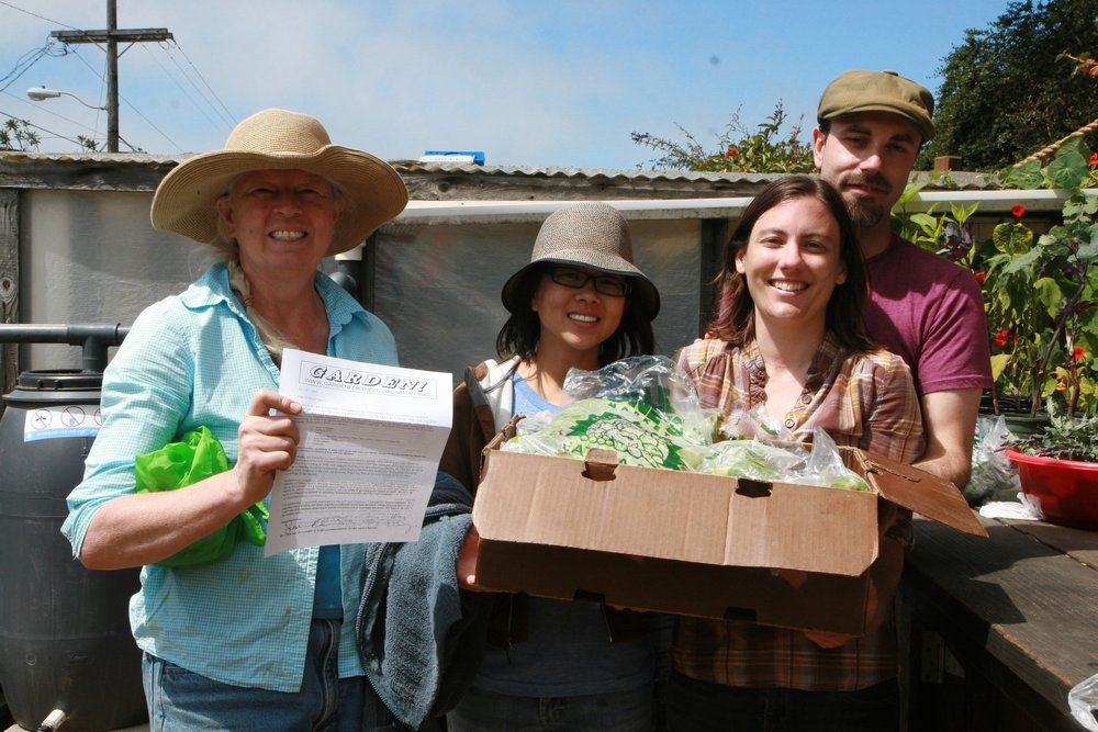 Hilary and volunteers showing off one of the first harvest boxes in 2009.