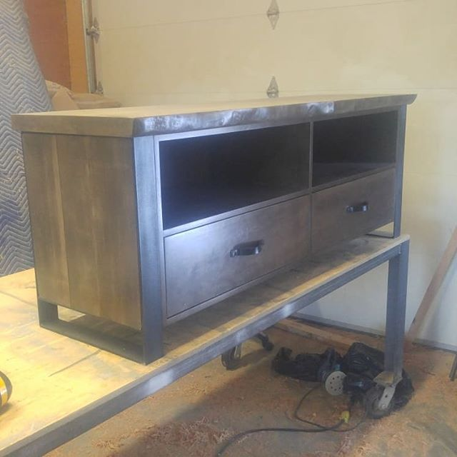 Part of one of our living room lines. Tv console in live edge hemlock with handmade  blacksmith handles by yours truly.