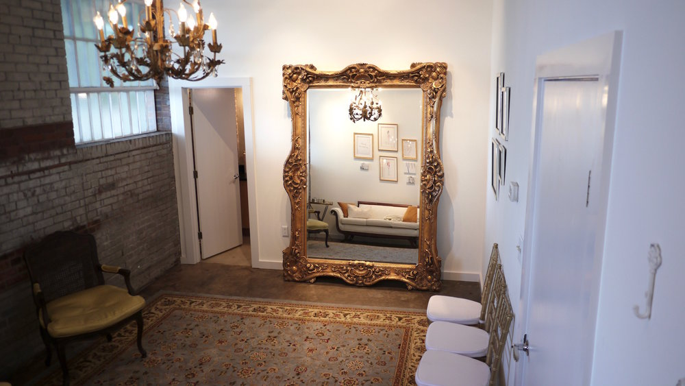Wide angle photo showcasing the mirror in our bridal suite