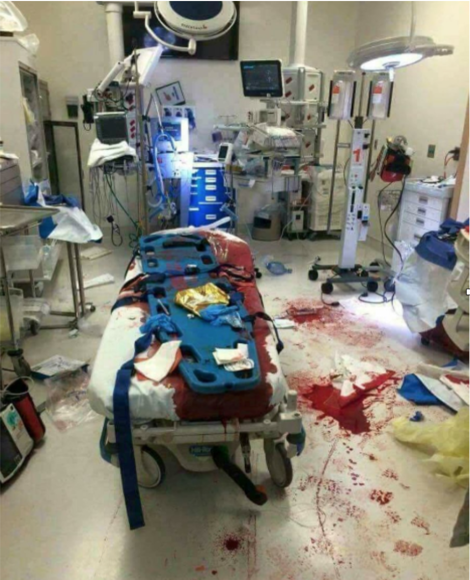 Figure 1 Trauma bay after event. Note the bloody footsteps.