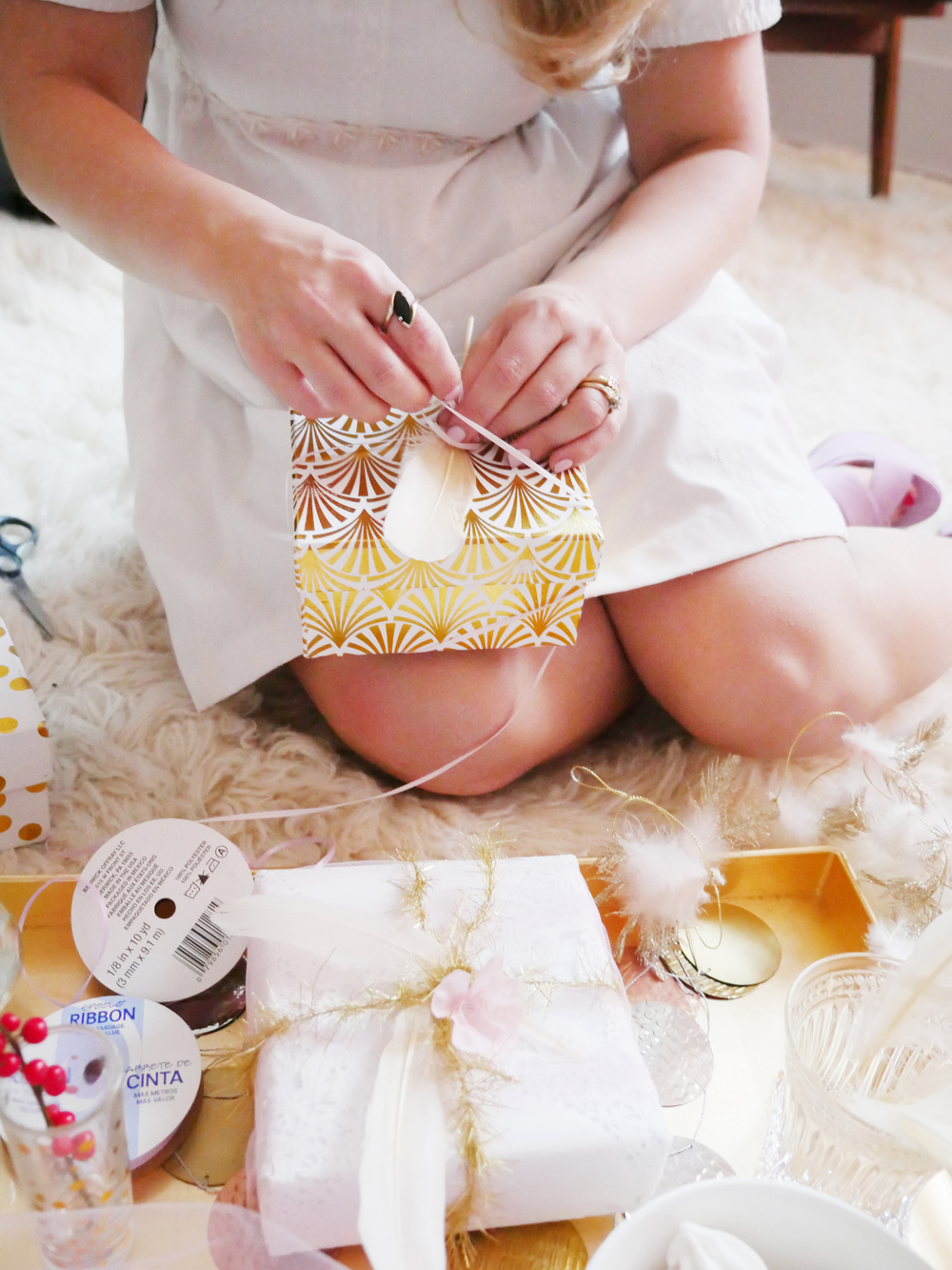 To go the simple route I always say get a pretty box and adorn it with a pretty ribbon or other cute elements. We found these beautiful gold and white boxes in Home Goods and tied a simple ribbon with a feather for a chic look.