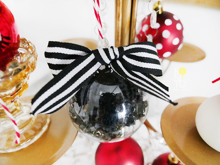 DIY Ornament. For this one I filled a clear ornament with black crinkle paper and used a glue dot to add a striped bow. Click  HERE  to see previous DIY ornament ideas.