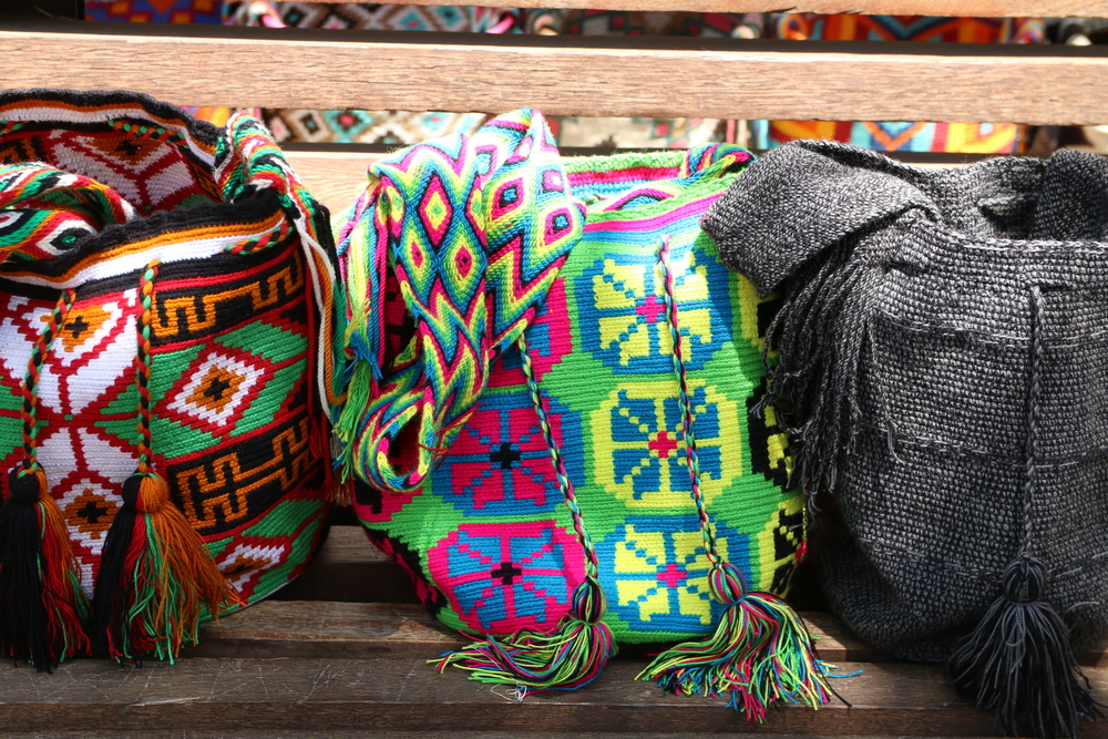 Flats, neons, and earth-tones all represent regional and cultural influences. Can you guess which one is which?