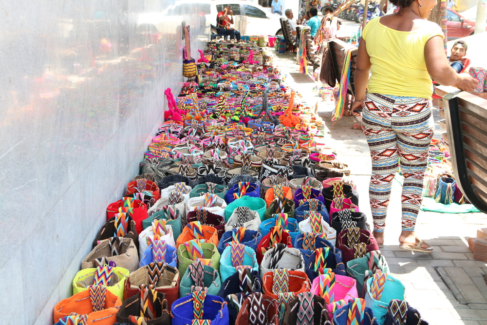 4 vendors sell side-by-side in this street market. Don't like what you see? On to the next one!