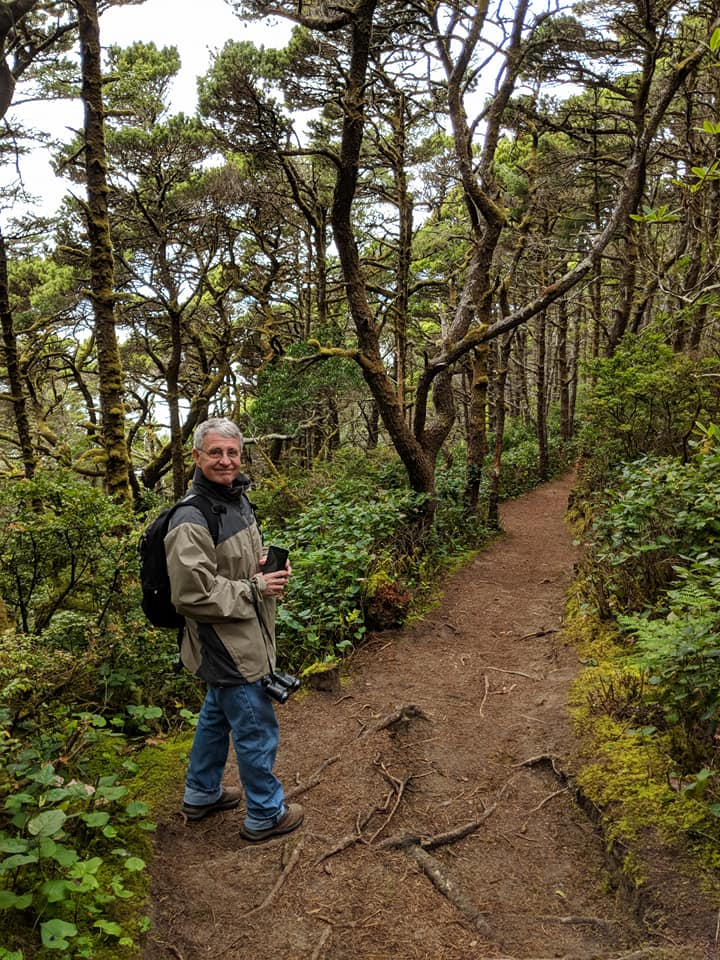 Jim Nechols enjoys a trail along the Oregon Coast, always keeping an eye out for invasive weeds. (Photo; Jim Nechols)