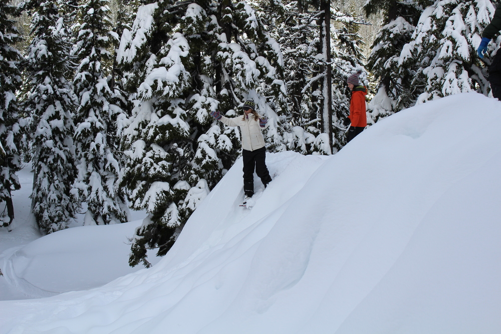 Running, gliding, and sliding down the slopes on snowshoes in the Deschutes National Forest.