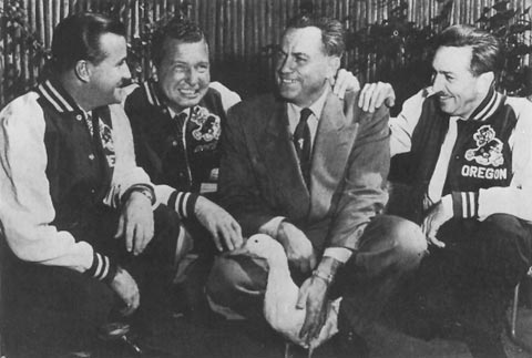 Walt Disney (right) wearing an Oregon Ducks jacket with Athletic Director Leo Harris.