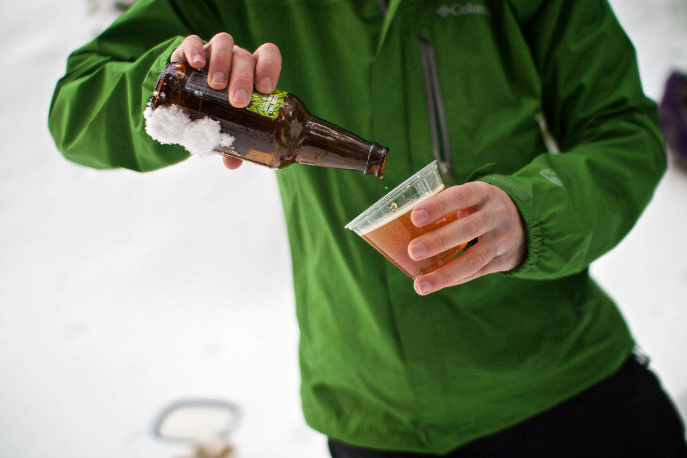 Join us for a locally crafted beer in the forest on our Shoes, Brews & Views Snowshoe Tour.