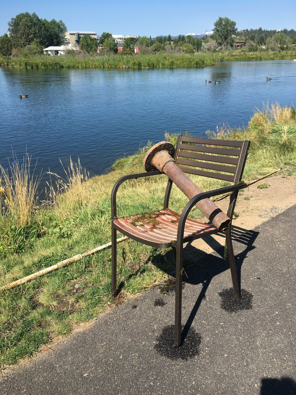 A patio chair and two wasted pipes were recovered from the bottom of the river.