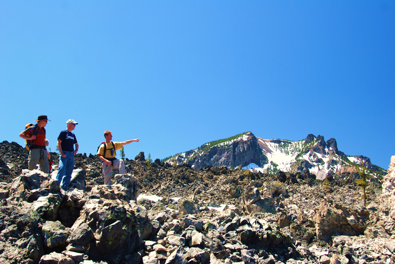 Wanderlust Tours leading a Volcano Tour in the obsidian flows of the Newberry Caldera