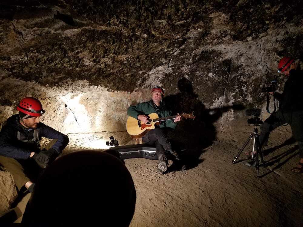 Survivorman Les Stroud performing in a cave for last summer's Art in Nature series.  Check out our upcoming Art in Nature event with Bend Camerata !