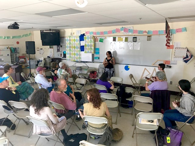 Teaching Beginning Ukulele 1 at NEFFA Festival in Mansfield, MA, April 2017. Photo by Claire Takemori, 2017.