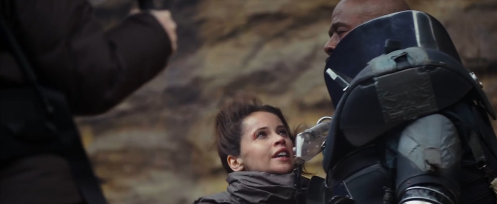 Jyn Erso talk (maybe pleading) with Saw Gerrera (no hair)....