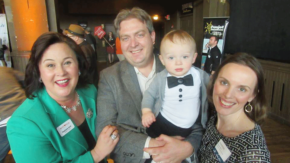 Wisconsin Department of Tourism Secretary Stephanie Klett along with Milwaukee Food & City Tours founder Theresa Nemetz,husband Wade, and son Enzo.
