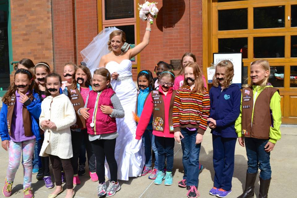Scouts photo bombing a bride (and Girl Scout alumna herself) during a Milwaukee Photo Walk in the Historic Third Ward.