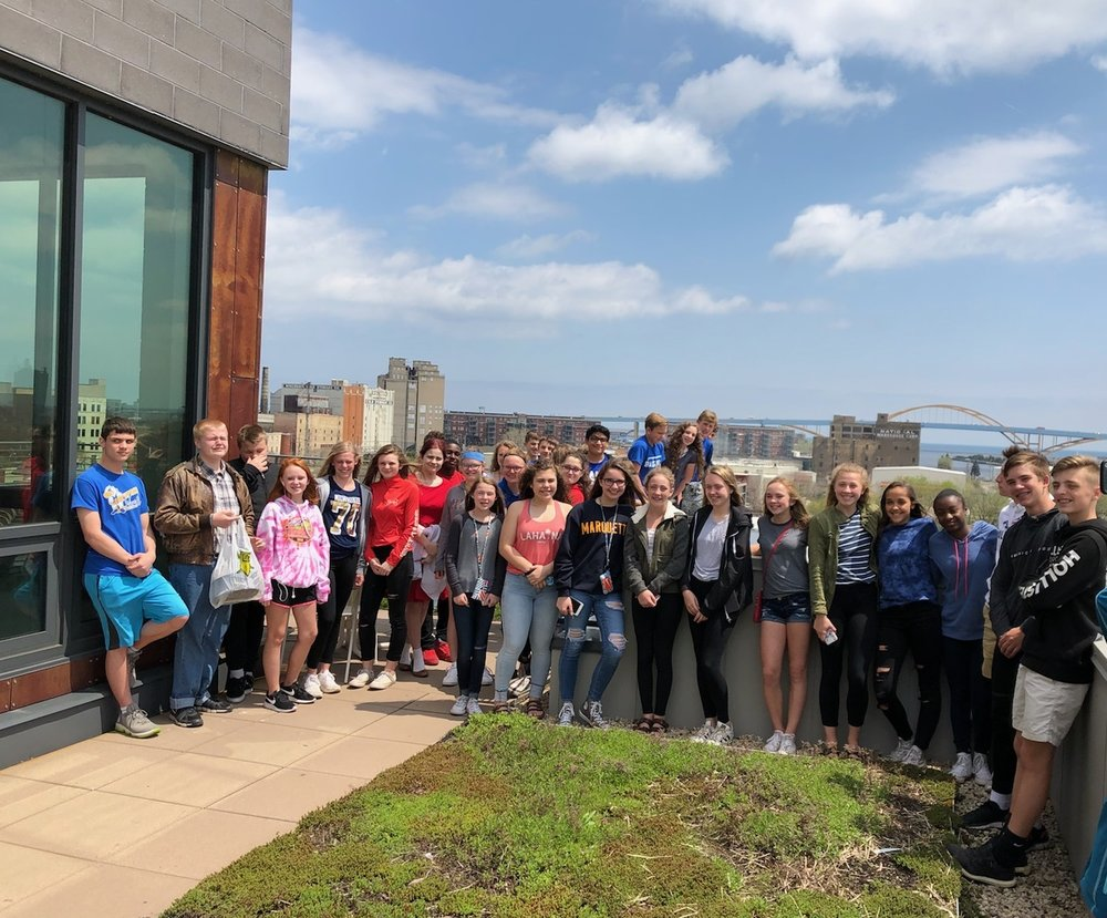 Students enjoying a rooftop view of Milwaukee during a Latinos of Milwaukee field trip.
