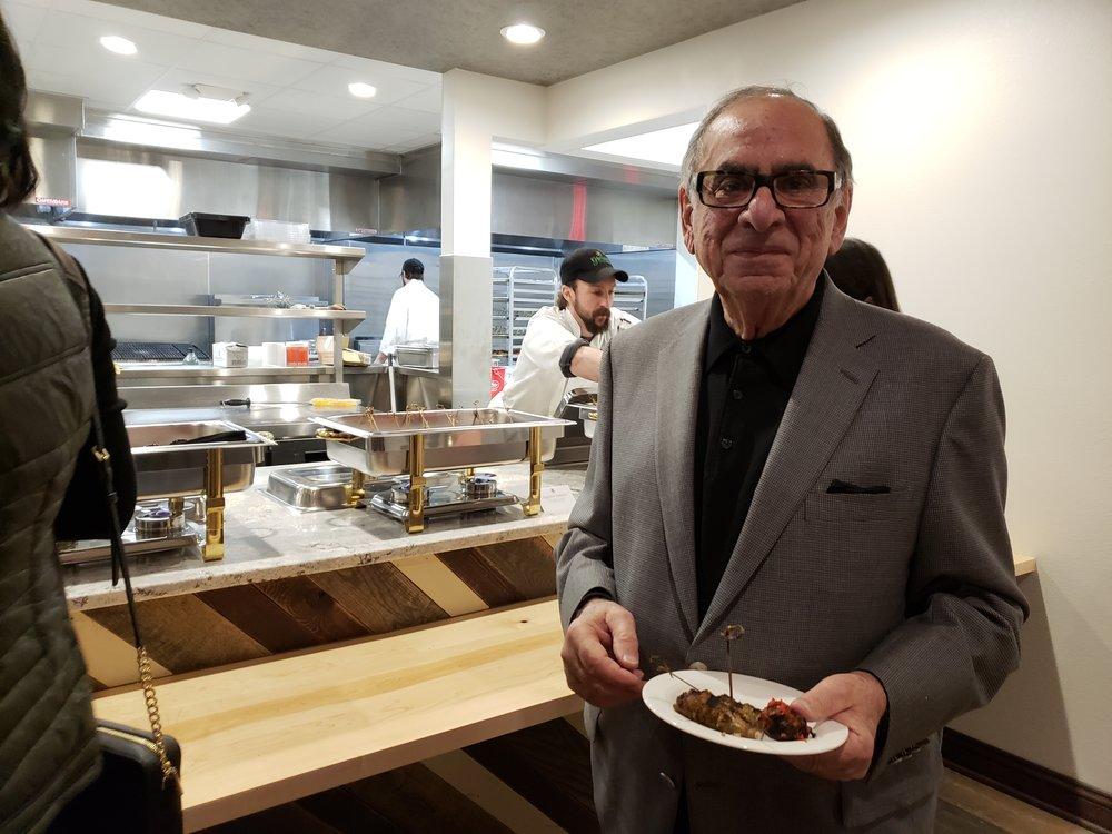 Ted Glorioso enjoying beef spiedini in the cucina