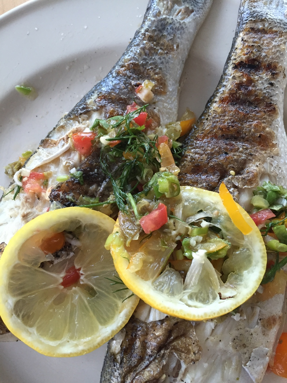 whole branzino, grilled with lemon and herbs