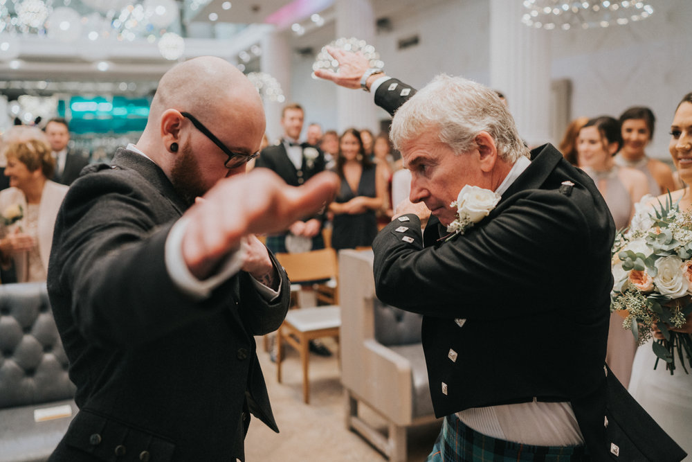 NUMBER #8.  DAB DAB DAB // Totally didn't see this coming! The groom and father of the bride high fived and dabbed instead of the traditional handing over of the bride.  Brilliant moment!