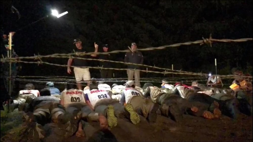 48 Hours Into Race. The Remaining 18 Racers Prepare For Drag Race Under Barbed Wire. The First 12 to Cross Finish Line Advanced to Win Skulls (Slevin on the Far Left Row, Foreground).