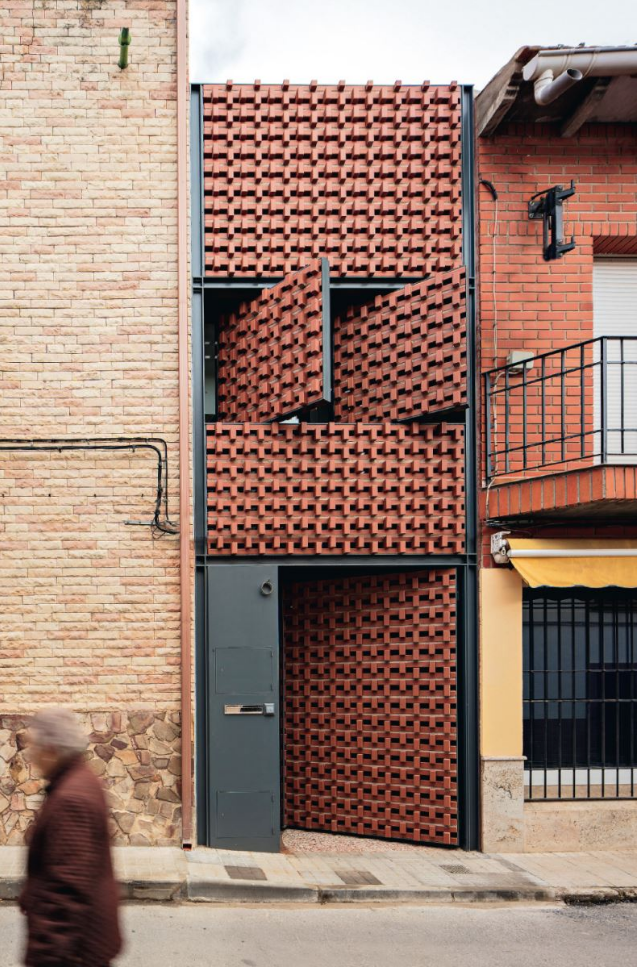 Front façade of Casa Piedrabuena by MUKA arquitectura in Ciudad Real, Spain as seen on http://www.arquitecturaviva.com/ Photo credit: MUKA arquitectura