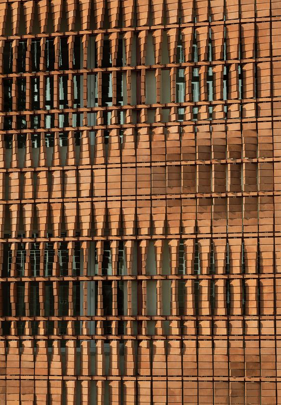 Close up of the façade of the Cloaked in Bricks by Admun Design & Construction Studio as seen on www.archdaily.com