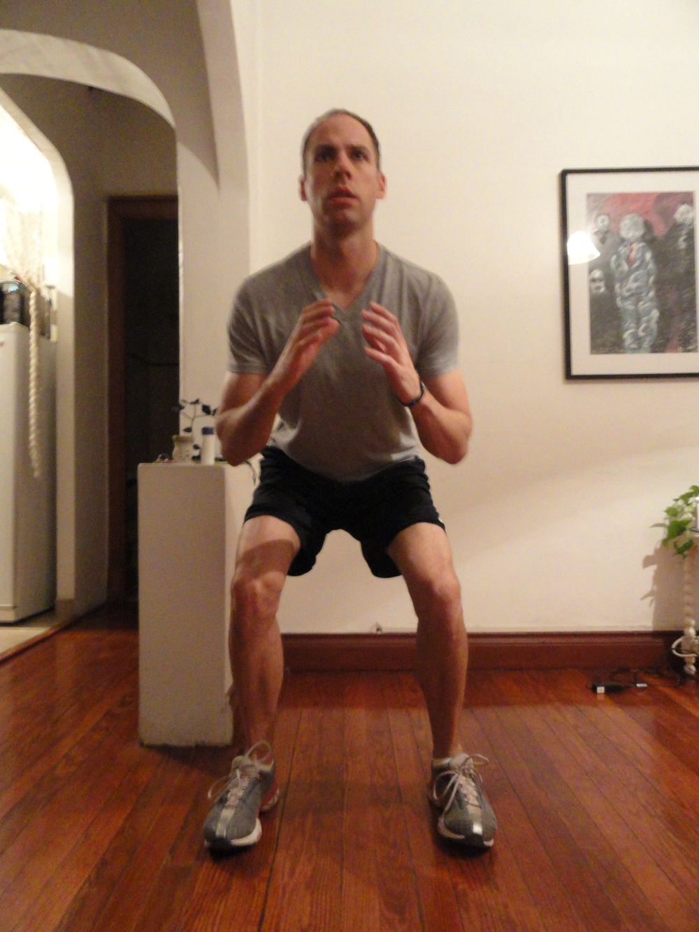 Position A for squatting side lunge: First squat deeply and stay there.