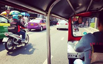 Effing terrified in a tuk tuk in Bangkok...Your life is literally on the line. The white one right there in the middle of traffic.