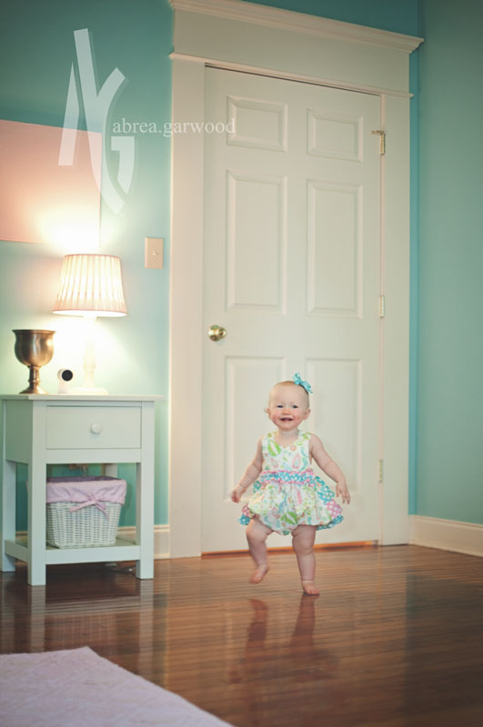 When we walked through the house to get to the backyard, I noticed Lynnlee's room matched her little outfit. :) So when we went inside to cool off for a few minutes, I got a few pictures of her in there as well! Love her happy smile here!