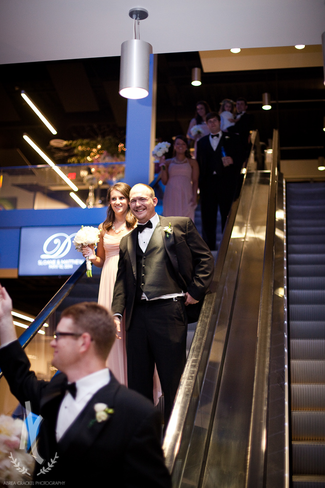 The wedding party was announced from the escalators.