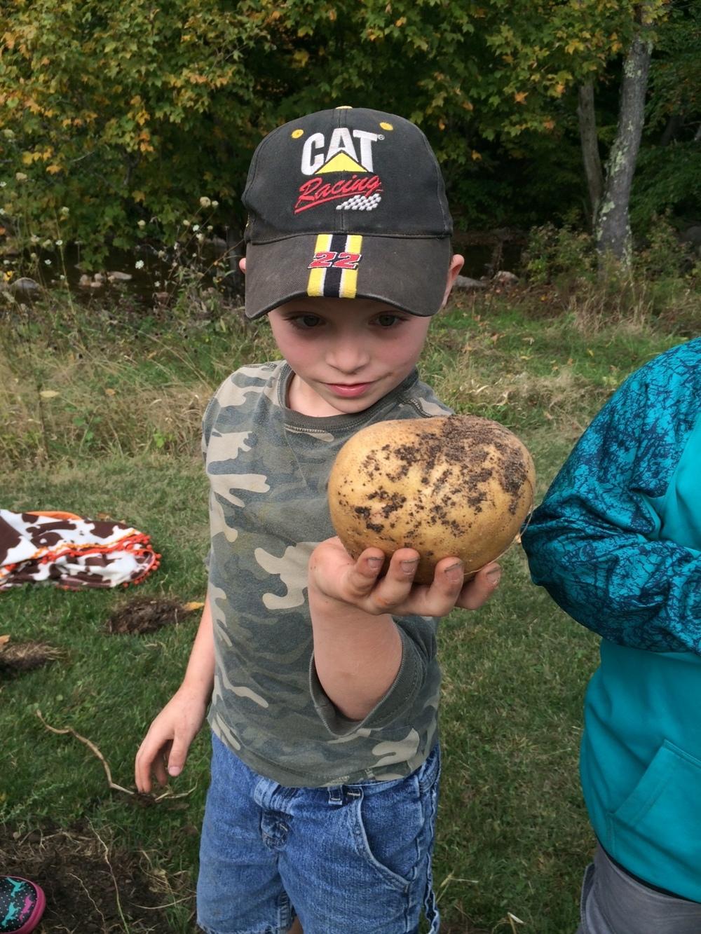 kid with potato.jpeg