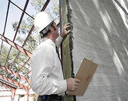 Engineer Inspecting Building Damage