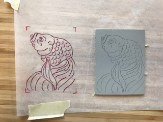 Next, I transferred the image onto a piece of linoleum using tracing paper and carbon transfer paper.