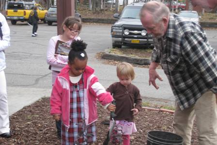Children of Immanuel help plant a tree after the service to represent our commitment to care for the earth and work towards its healing  .