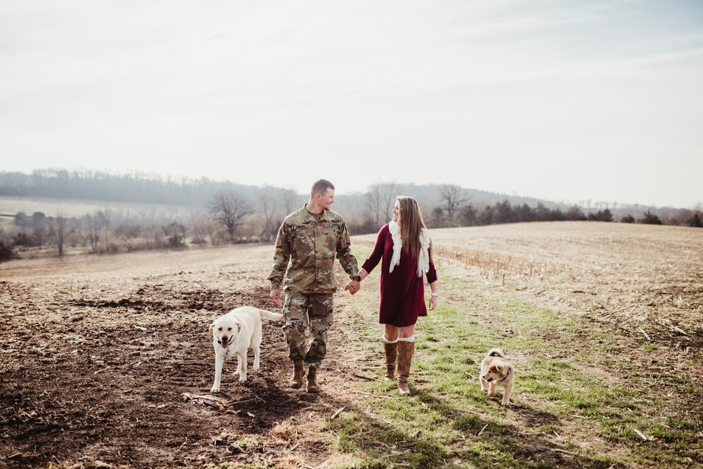 engagement photo holding hands walking with dogs.jpg