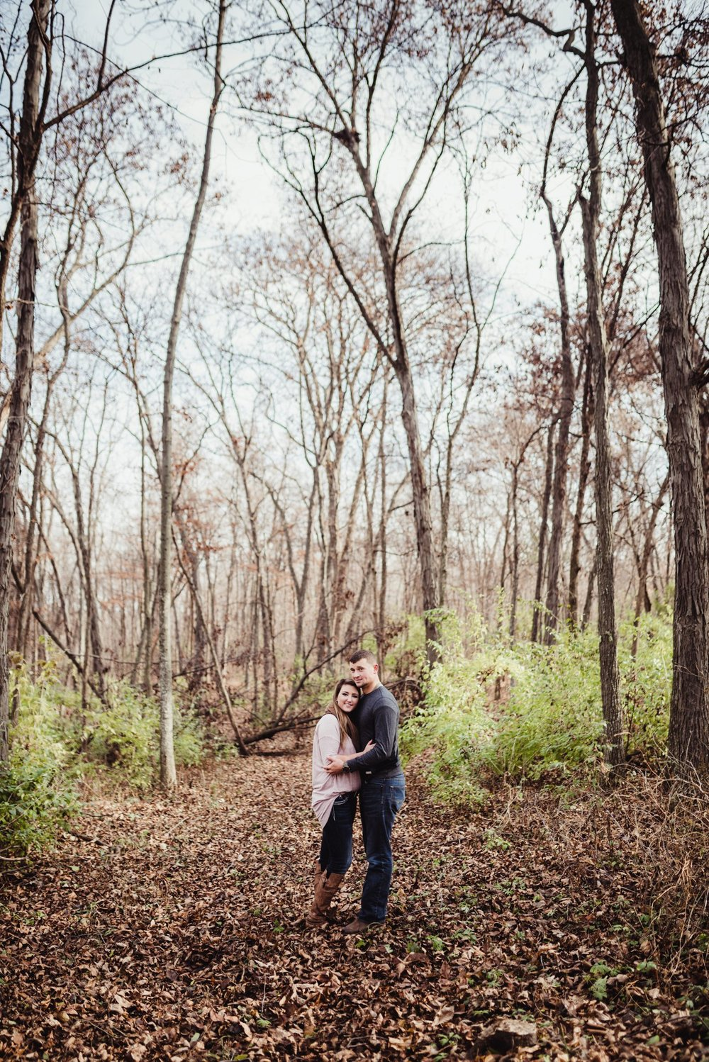 engagement photo in woods far away.jpg