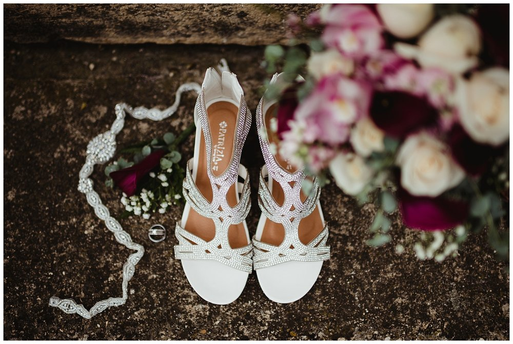Kayla E. Photography shoes bouquet wedding rings.jpg