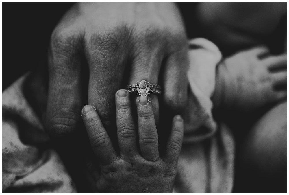 in home lifestyle newborn session madison wi emotive story telling hands black and white kayla e photography emotion.jpg