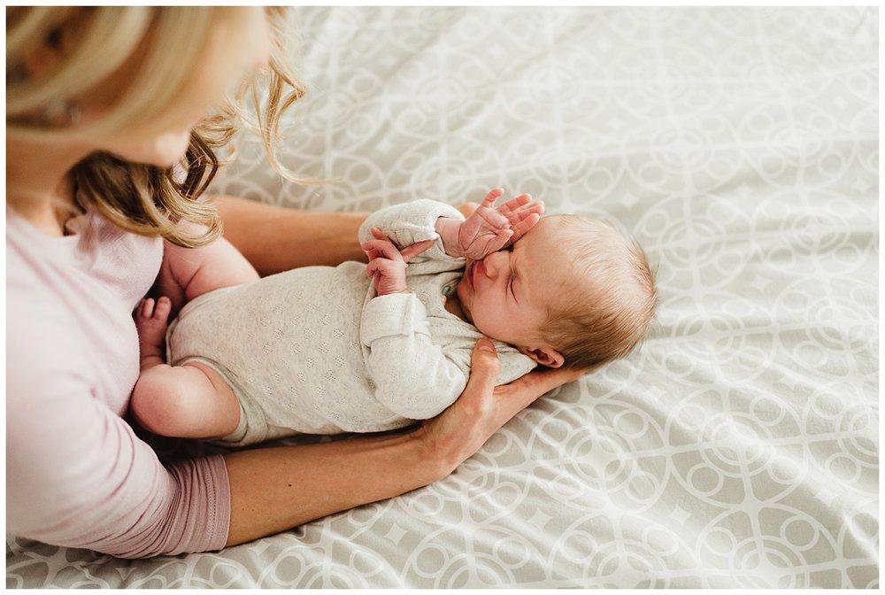 in home lifestyle newborn session madison wi sleepy baby.jpg