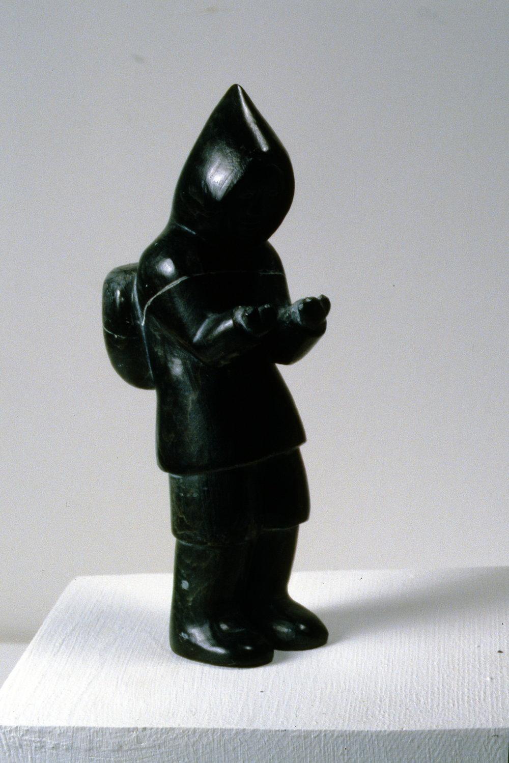Man Carrying Pack, n.d., Noah Arnaquq, carved stone, 15.2 x 6 x 4.5cm, 1998.01.31