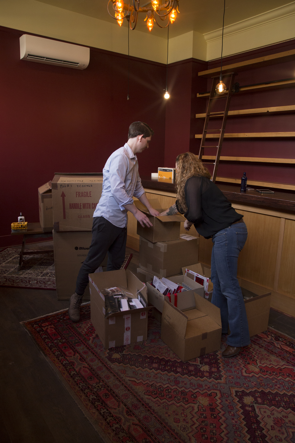 Tracy and André unpack product two days before the soft opening.