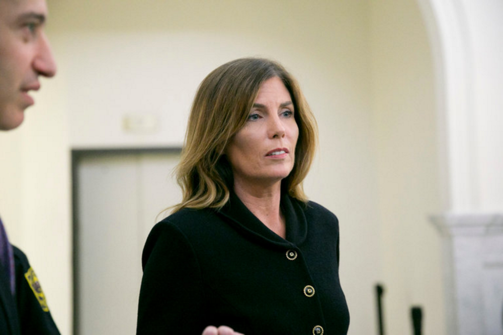 The Pennsylvania attorney general, Kathleen G. Kane, left the courtroom on Monday after closing arguments in her perjury and obstruction trial at the Montgomery County Courthouse in Norristown.  CreditPool photo by Jessica Griffin