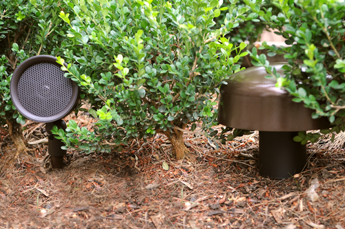 Speakers blend into your landscaping. The mushroom looking thing is an inground subwoofer!