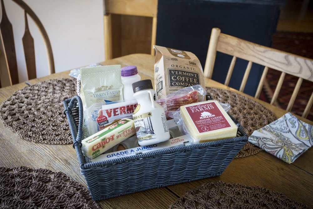 Complimentary breakfast basket with locally produced cheese, bacon, coffee, eggs, pancake mix, maple syrup and more