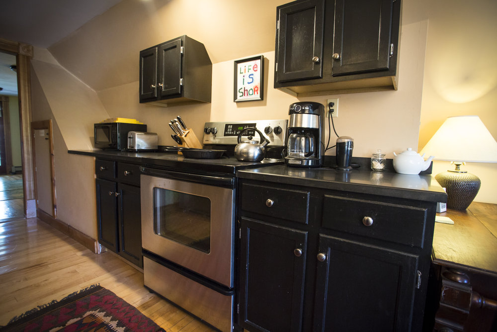 "Right Wing kitchen - stainless oven, 36"" refrigerator, dishwasher, handcrafted granite counters."